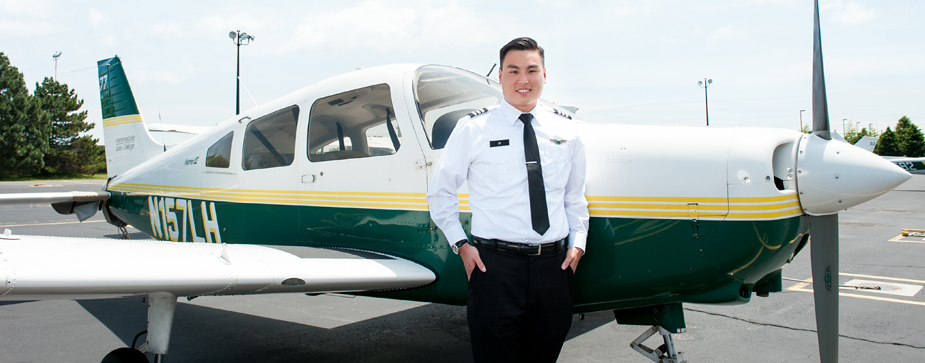 Aviation student standing in front of plane